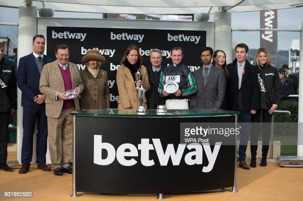 Camilla Duchess of Cornwall Honorary Member of the Jockey Club makes a presentation to the winners of The Betway Queen Mother Champion Steeple Chase...
