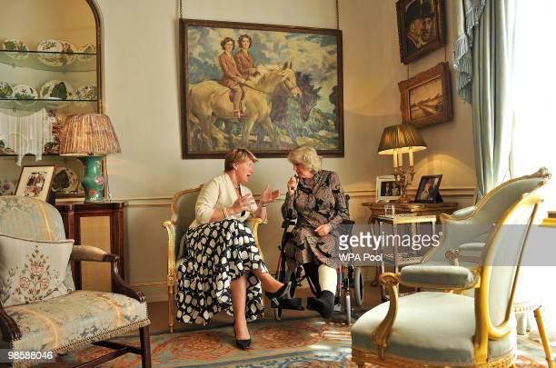 Camilla Duchess of Cornwall in her wheelchair chats to British television presenter Claire Balding during a reception at Clarence House on April 21...