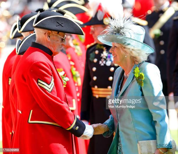Camilla, Duchess of Cornwall inspects the Chelsea Pensioners taking part in the Founder's Day Parade at the Royal Hospital Chelsea on June 6, 2013 in...