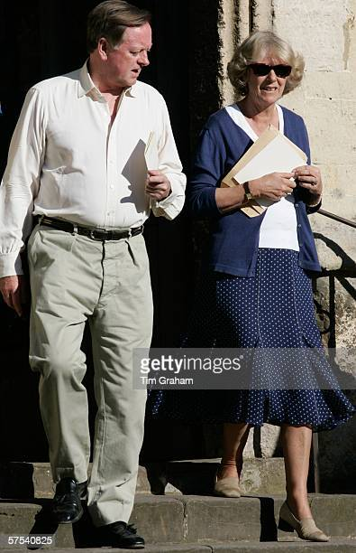 Camilla Duchess of Cornwall is accompanied by her exhusband Andrew ParkerBowles at the wedding rehearsal for the marriage of their daughter Laura...