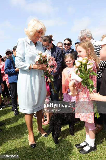Camilla, Duchess of Cornwall is given flowers as she visits Lincoln Farmer's and Craft Market on November 23, 2019 in Christchurch, New Zealand. The...