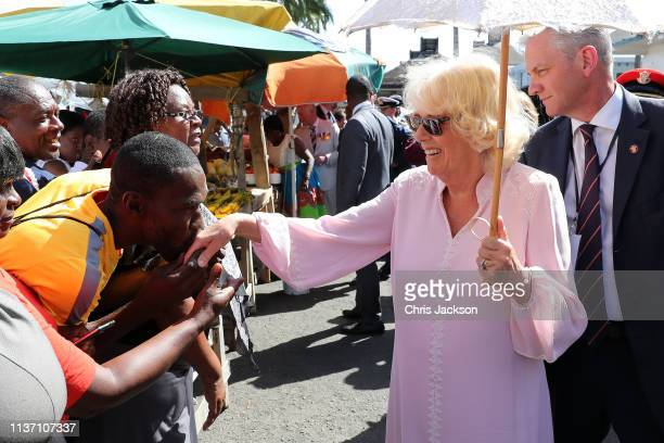 Camilla Duchess of Cornwall is greeted by a local as she visits Kingstown Market on March 20 2019 in Kingstown Saint Vincent and The Grenadines The...