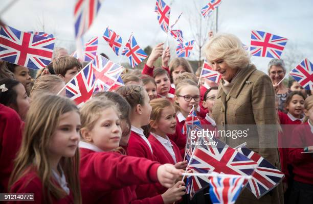 Camilla Duchess of Cornwall is greeted by flag waving school pupils as she visits Marlborough St Mary's Church of England Primary School in...