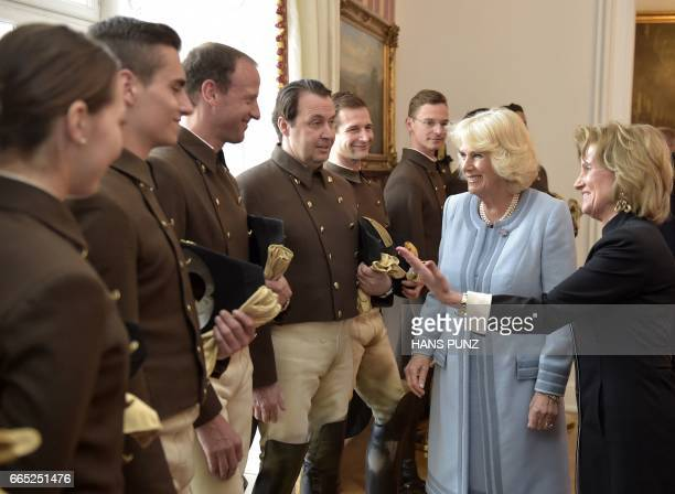 Camilla Duchess of Cornwall is introduced to the riders by the General Manager of the Spanish Riding School Elisabeth Guertler on April 6 in Vienna...