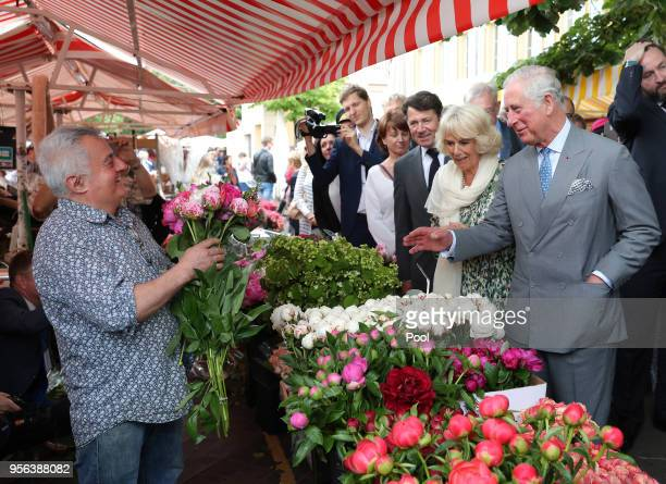 Camilla Duchess of Cornwall is presented with a rose during a visit Nice Flower Market on May 9 2018 in Nice France Prince Charles Prince of Wales...