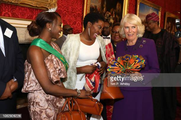Camilla Duchess of Cornwall is presented with an ornate fan by Founder of Miss Nigeria UK Ganyiat Adeshola Olufunke Alli at a reception to mark their...