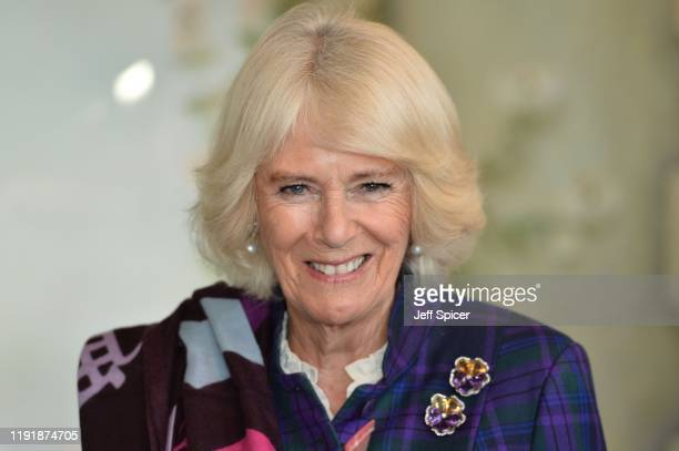 Camilla, Duchess of Cornwall is seen attending a fan making class during a visit of The Fan Museum on December 04, 2019 in Greenwich, England.