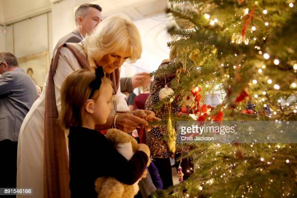 Camilla Duchess of Cornwall is seen with children from Helen Douglas House and Roald Dhal's Marvellous Children's Charity decorating the Clarence...