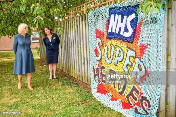 Camilla, Duchess of Cornwall is shown a knitted tribute to NHS staff by Chief Executive Officer, Gloucestershire Hospitals NHS Foundation, Deborah...
