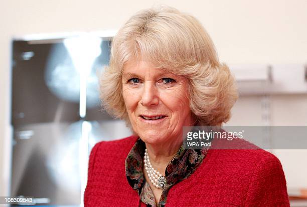 Camilla Duchess of Cornwall is shown a mammogram scanner during a visit to Nottingham Breast Institute on January 25 2011 in Nottingham England The...