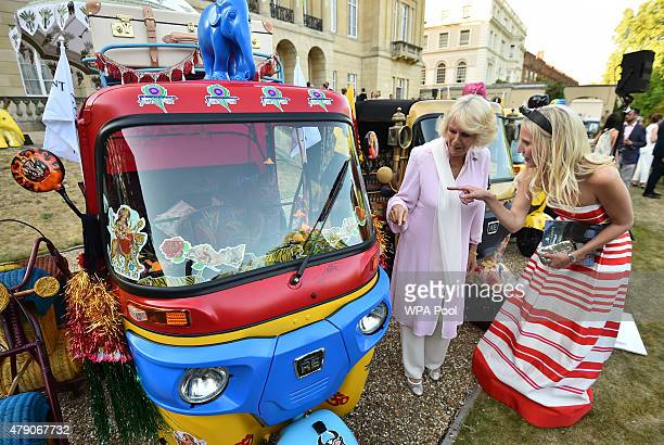 Camilla Duchess of Cornwall is shown a rickshaw designed by her sister Annabel Elliot and Luke Irwin at a Travels To My Elephant Royal Richshaw Event...