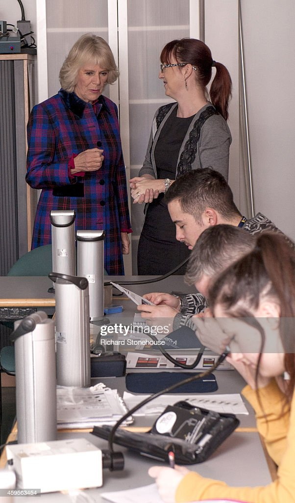 Camilla, Duchess of Cornwall is shown around the microscopy class by Gaynor Andrews and views precious stones during a visit the Birmingham University School of Jewellery on November 25, 2014 in Birmingham, England.