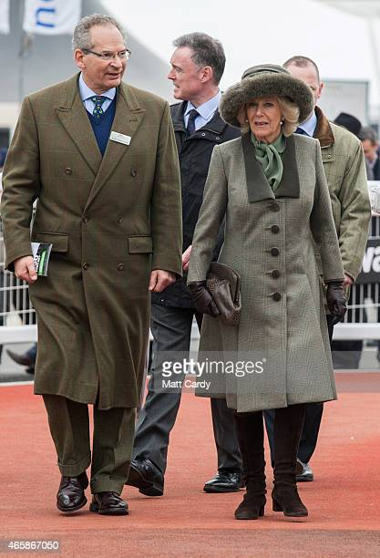 Camilla Duchess of Cornwall is shown around the paddock by Chairman of Cheltenham racecourse Robert WaleyCohen on the second day of the Cheltenham...