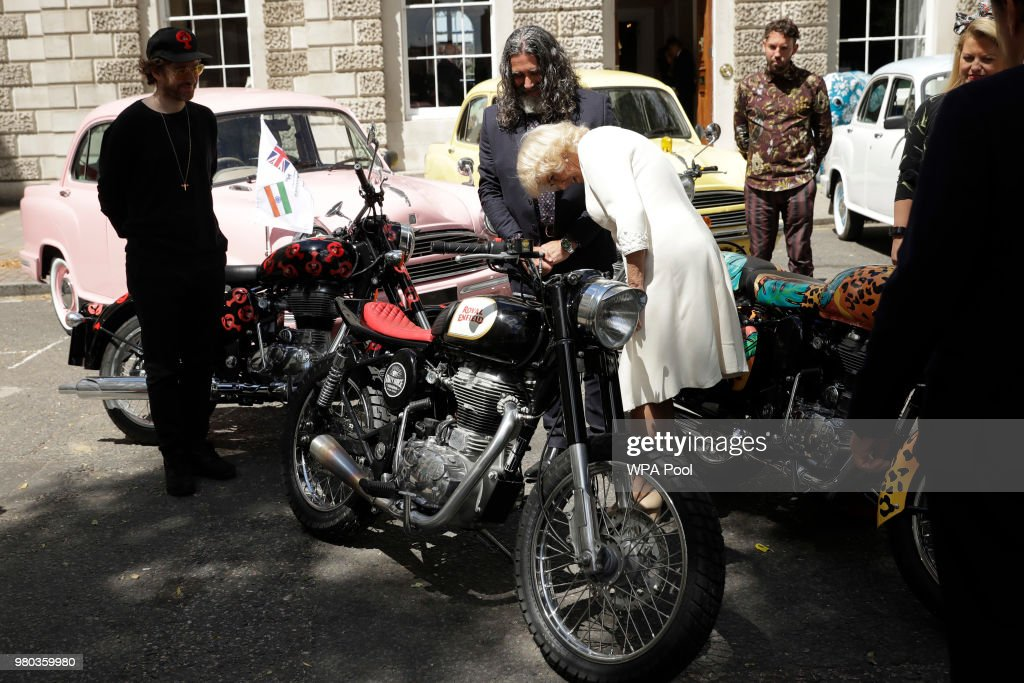 Camilla Duchess of Cornwall Joint President Elephant Family looks at a Royal Enfield motorbike before officially launching the Concours d`elephant a..