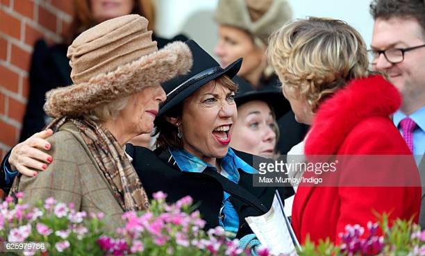 Camilla Duchess of Cornwall Kathy Lette and Madeleine Lloyd Webber watch the racing as they attend the 60th Hennessy Gold Cup at Newbury Racecourse...