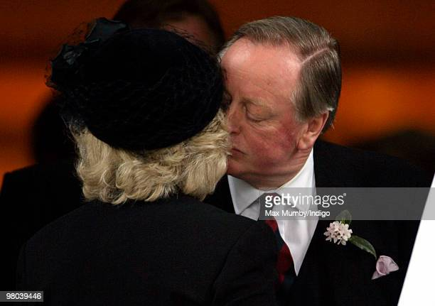 Camilla Duchess of Cornwall kisses ex-husband Andrew Parker Bowles as they attend a memorial service for Andrew's late wife Rosemary Parker Bowles at...