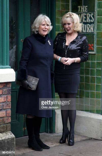 Camilla Duchess of Cornwall laughs as she chats to cast member Beverley Callard during a tour of the Coronation Street set on February 4 2010 in...
