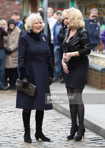 Camilla, Duchess of Cornwall laughs as she chats to cast member Beverley Callard during a tour of the Coronation Street set on February 4, 2010 in...