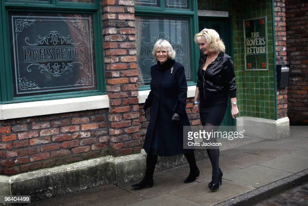 Camilla Duchess of Cornwall laughs as she chats to cast member Beverley Callard outside The Rovers Return during a tour of the Coronation Street set...