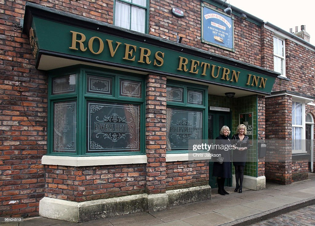 Camilla, Duchess of Cornwall laughs as she chats to cast member Beverley Callard outside The Rovers Return during a tour of the Coronation Street set on February 4, 2010 in Manchester, England.