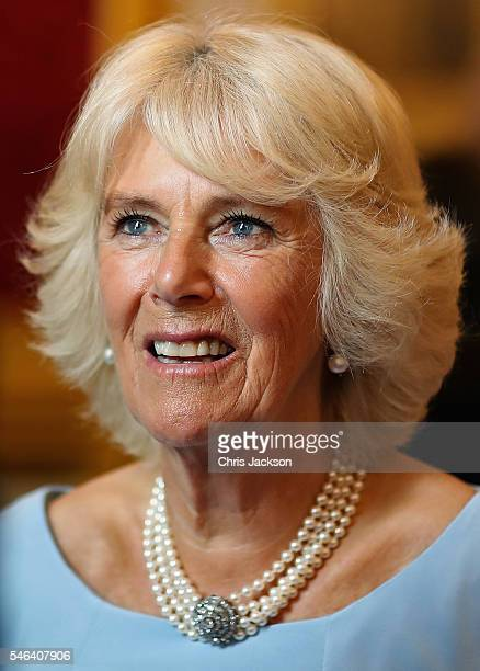 Camilla Duchess of Cornwall laughs as she hosts the 30th Anniversary Garden Party for the National Osteoporosis Society in St James Palace on July 12...