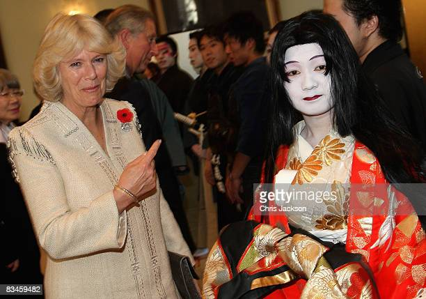 Camilla Duchess of Cornwall laughs with a traditionally dressed actress during a visit to Keio University on October 28 2008 in Tokyo Japan Prince...