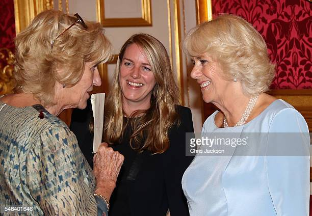 Camilla Duchess of Cornwall laughs with her daughter Laura Lopes and Annabel Elliot she hosts the 30th Anniversary Garden Party for the National...