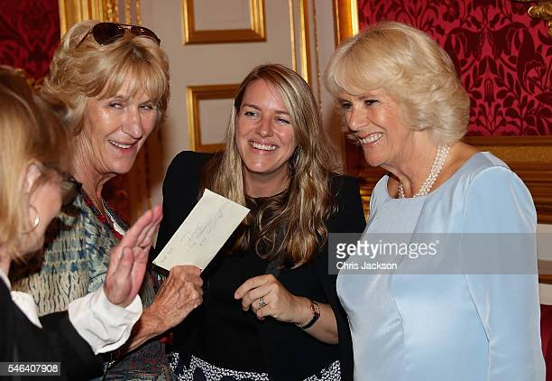 Camilla Duchess of Cornwall laughs with her daughter Laura Lopes and Annabel Elliot as she hosts the 30th Anniversary Garden Party for the National...