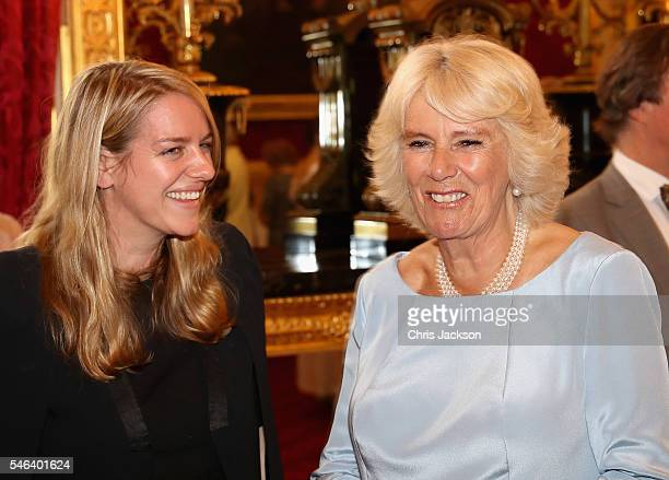 Camilla Duchess of Cornwall laughs with her daughter Laura Lopes as she hosts the 30th Anniversary Garden Party for the National Osteoporosis Society...