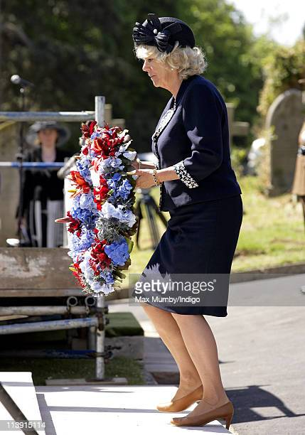 Camilla Duchess of Cornwall lays a wreath as she attends a commemorative service for Commonwealth servicemen at hastings cemetry on May 10 2011 in...