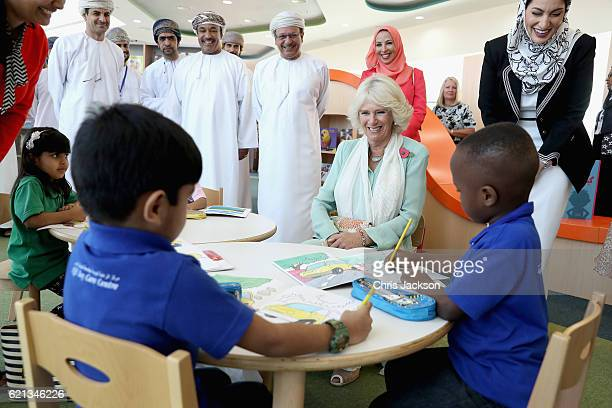 Camilla Duchess of Cornwall listens to a youg boy give a reading as she visits Oman's first Children's public library on the third day of a Royal...