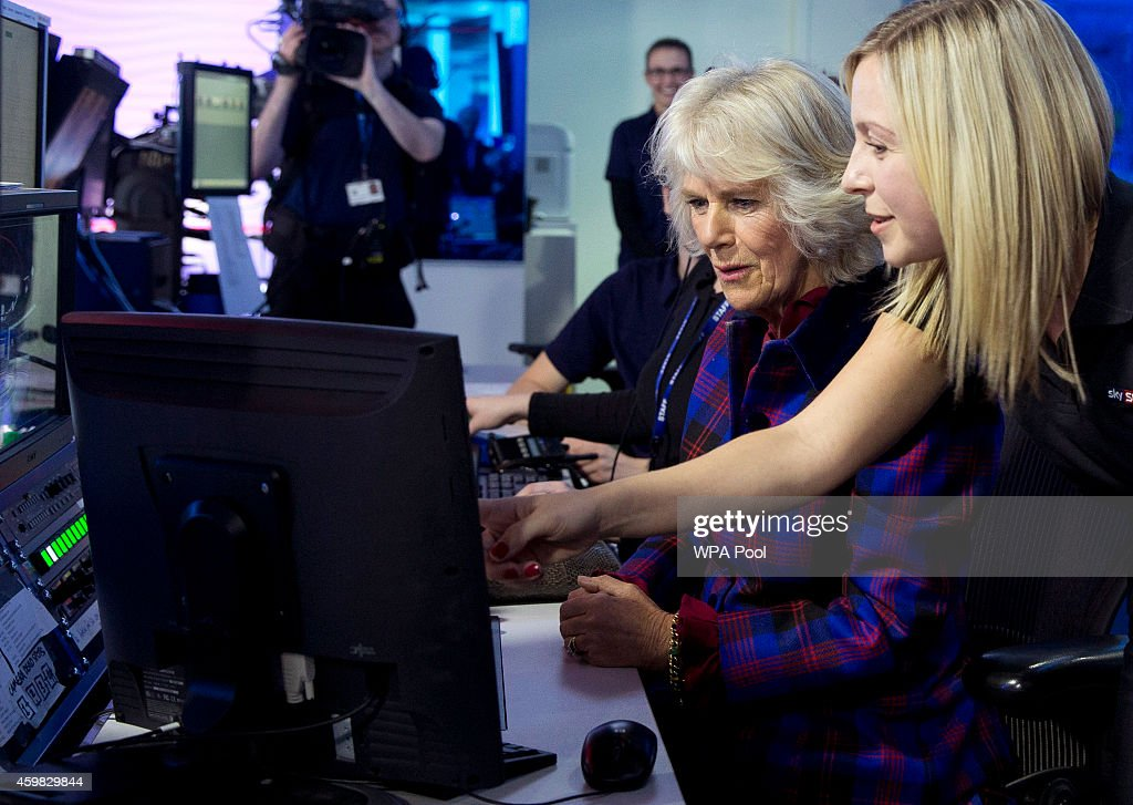 Camilla, Duchess of Cornwall looks at a monitor with Sky employee Rachel Applin, that remotely controls TV cameras at the Sky Sports news studio during a visit to Sky on December 2, 2014 in London, England.