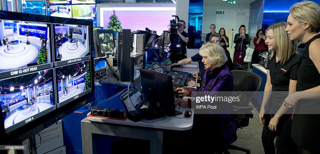 Camilla, Duchess of Cornwall looks at a monitor with Sky employees Rachel Applin and Melissa Bartlett that remotely controls TV cameras at the Sky Sports news studio during a visit to Sky on December 2, 2014 in London, England.