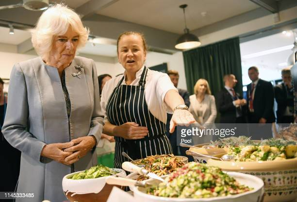 Camilla Duchess of Cornwall looks at food as she visits the Avoca Mill on May 21 2019 in County Wicklow Ireland The Prince of Wales and the Duchess...