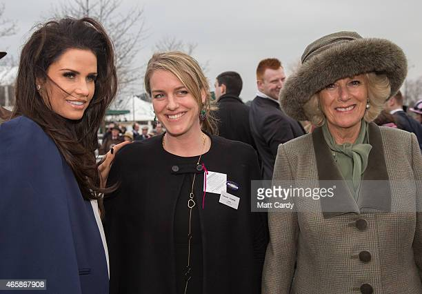 Camilla Duchess of Cornwall looks at horses in the paddock with daughter Laura Lopes and Katie Price on the second day of the Cheltenham Festival on...