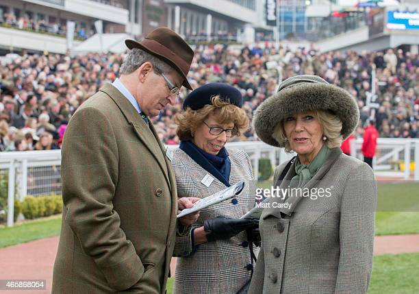 Camilla Duchess of Cornwall looks at horses in the paddock with Cheltenham Racecourse Chairman Robert Waley Cohen on the second day of the Cheltenham...
