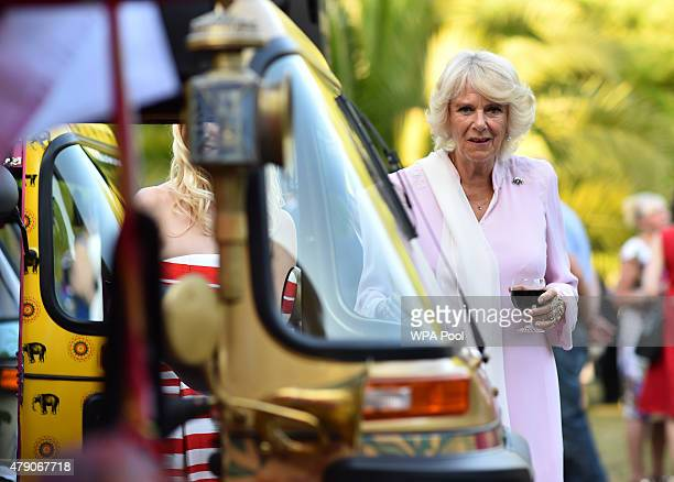 Camilla Duchess of Cornwall looks at rickshaws during a Travels To My Elephant Royal Richshaw Event in support of the Elephant Family a charity set...