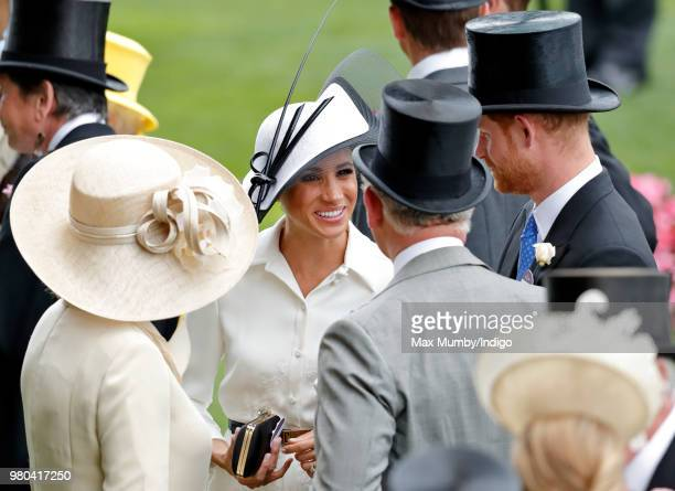 Camilla Duchess of Cornwall looks on as Meghan Duchess of Sussex talks with Prince Charles Prince of Wales and Prince Harry on day 1 of Royal Ascot...