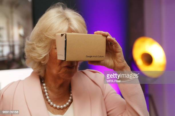 Camilla, Duchess of Cornwall looks through a virtual reality viewer during a visit to the YouTube Space London at Kings Cross on May 16, 2018 in...