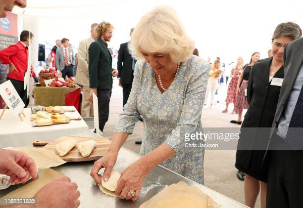 Camilla Duchess of Cornwall makes a Cornish Pasty ahead of a garden party to celebrate the 50th anniversary of Ginsters Bakery during an official...