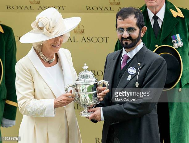 Camilla Duchess of Cornwall makes a presentation to Sheikh Mohammed Bin Rashid Al Maktoum on Day 1 of Royal Ascot at Ascot Racecourse on June 18 2013...