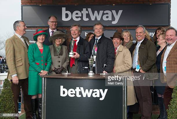 Camilla Duchess of Cornwall makes a presentation to the owners including Martin Broughton of the winning horse in the Betway Queen Mother Champion...