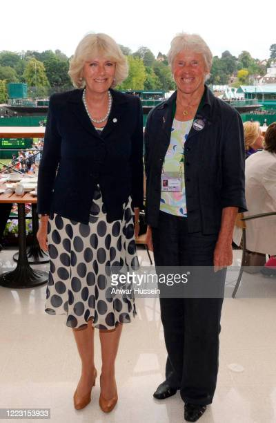 Camilla Duchess of Cornwall meets Anne Jones during the third day of Wimbledon at the All England Lawn Tennis and Croquet Club on June 22 2011 in...