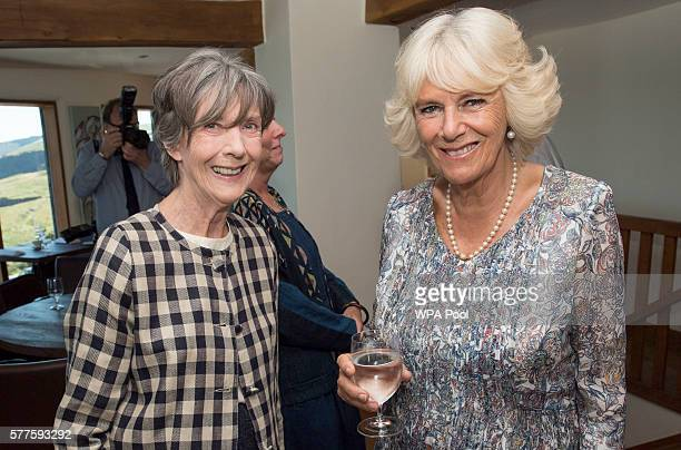 Camilla Duchess of Cornwall meets cast member of the TV show 'Doc Martin' Eileen Atkins at Nathan Outlaw's restaurant during a visit to Port Isaac on...