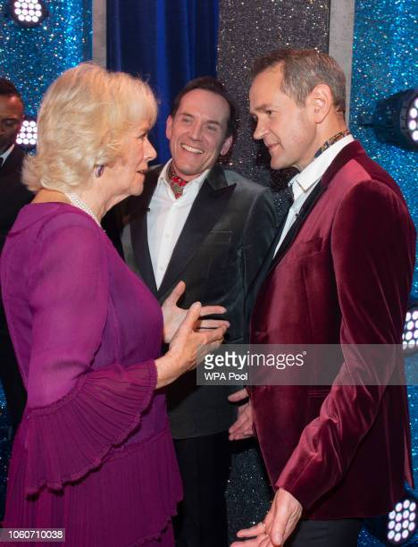 Camilla Duchess of Cornwall meets cast members Ben Miller and Alexander Armstrong after attending a one off performance of 'We Are Most Amused and...