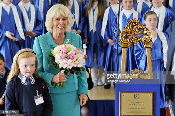 Camilla Duchess of Cornwall meets Charlotte Elizabeth Curran who celebrated her 8th birthday during the Duchess' visit to Claddagh Primary School to...