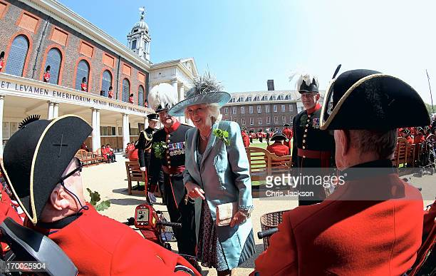 Camilla Duchess of Cornwall meets Chelsea Pensioners as she visits the Royal Hospital Chelsea to review The Founder's Day Parade on June 6 2013 in...