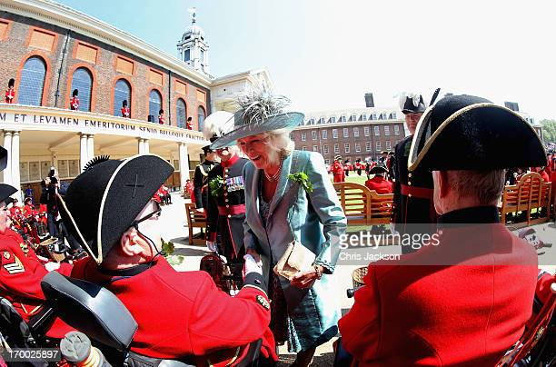 Camilla, Duchess of Cornwall meets Chelsea Pensioners as shel visits the Royal Hospital Chelsea to review The Founder's Day Parade on June 6, 2013 in...