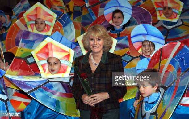 Camilla, Duchess of Cornwall meets children in colourful costumes when tours St. Alban's Cathedral on January 26, 2006 in St Albans, England.