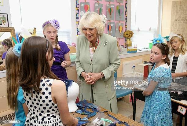 Camilla Duchess of Cornwall meets children who were making fascinators during a visit to Immanuel Christian School on May 20 2014 in Charlottetown...